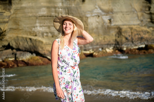 The summer holidays and vacation concept girl in dress standing on the beach