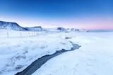 Spectacular arctic scenery of Haukland beach in Norway on Lofoten islands - iconic travel destination of nature lovers. Majestic scene on northern arctic beach on March. Norwegian sea coastline.