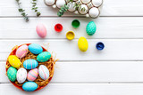 Colorful Easter eggs and paint for celebration on white background top view mock up