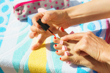 Woman pedicure with red nail polish