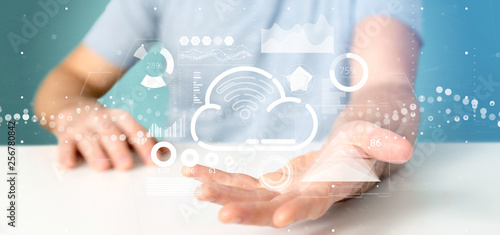 Businessman holding Cloud and wifi concept with icon, stats and data 3d rendering