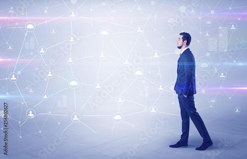 Leinwandbild Motiv Linking people concept with lonely elegant businessman who walking somewhere