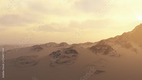 Snowy mountains in misty sunrise.