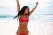 Leinwandbild Motiv Woman having a great time at beach