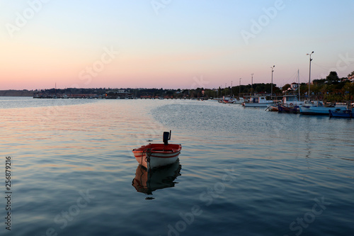 Fishing boat on Thermaikos Gulf at sunset. View of Nea Michaniona port, Thessaloniki, Greece.