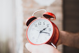 Early rise to work - a big red alarm clock