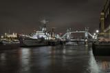 Three symbols of London - HMS Belfast, Tower Bridge and Tower of London at night