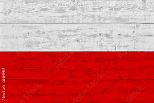 Poland flag painted on old wood plank