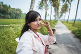selfie asian woman posing to camera outdoor in tropical summer holiday