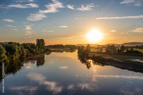 Leinwandbild Motiv The sunset over river Weser in Germany
