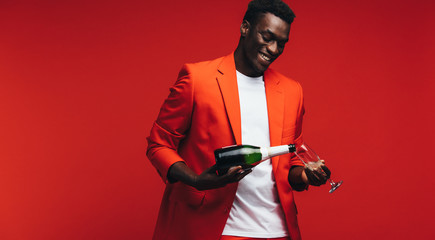 Handsome african guy having champagne