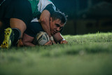Fototapeta Fototapety sport - Rugby player pins down opponent © Jacob Lund