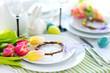 Leinwandbild Motiv Beautiful table setting with crockery and flowers for Easter celebration.