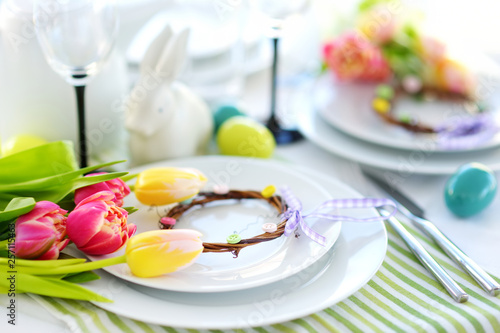 Beautiful table setting with crockery and flowers for Easter celebration. - 257115463