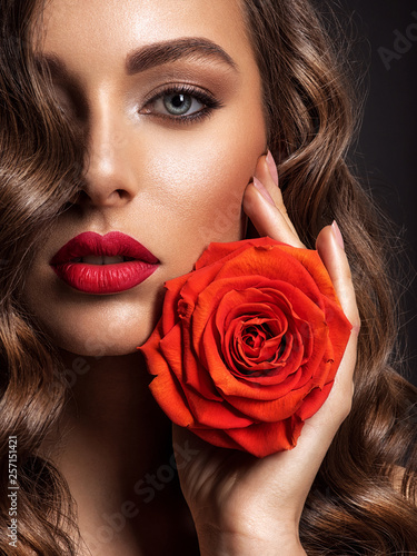 canvas print picture Beautiful woman with brown hair. Beautiful face of an attractive model with fashion makeup.