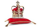 Golden crown on red velvet pillow for coronation. Royal symbol of british UK monarchy. - 257173038