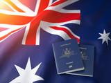 Passport of Australia on the australian flag. Getting a passport of Australia,  naturalization and immigration concept. - 257173214