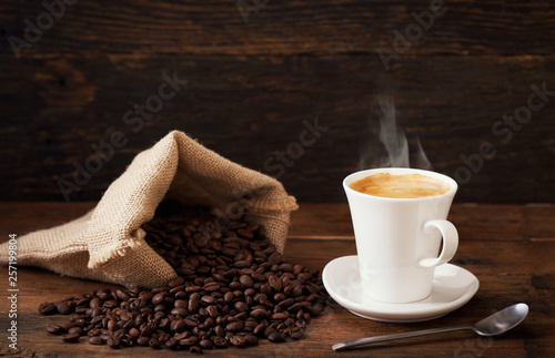 cup of coffee and coffee beans - 257199804