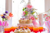 Dessert table with cupcakes and flowers Easter party theme - 257208266