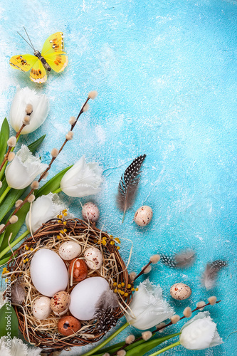 Easter composition with Easter eggs in nest,pussy willow branches and white tulips - 257213263