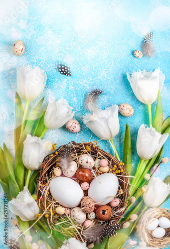 Easter composition with Easter eggs in nest,pussy willow branches and white tulips