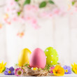 Quadro Easter composition with colorful Easter eggs  and spring flowers.