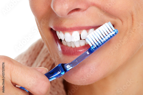 Woman teeth with toothbrush. © Kurhan