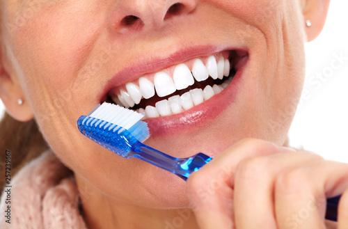 Woman teeth with toothbrush. © Kurhan