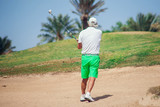 Man Playing Golf on Beautiful Sunny Green Golf Course. Sport and lifestyle concept