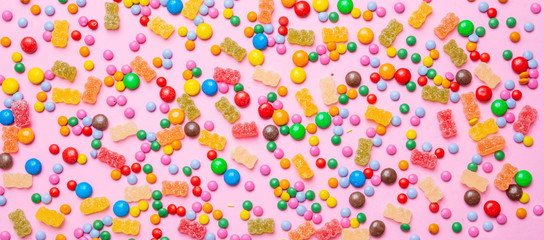 Birthday concept. Colorful sweet candies on pink background © Rawf8