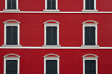 Typical building facade red and white color with windows in La Spezia, Italy