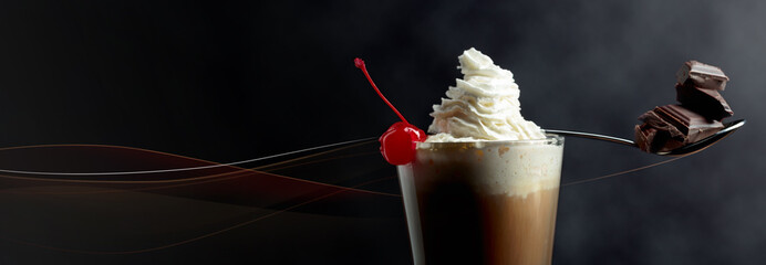 Layered coffee cocktail with whipped cream, cherry and pieces of chocolate. © Igor Normann