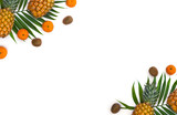 Frame of fresh tropic fruits orange mandarines, green kiwi, pineapples on palm tree leaf on white background with space for text. Top view, flat lay