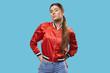 Leinwandbild Motiv Youth style. Portrait of model in bright red bomber.