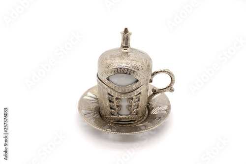Coffee cup on a white background. turkish coffee cup with metal frame.urkish coffee in a white cup isolated on a motifed background (path included) Traditional Turkish Coffee © Mustafa