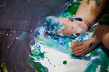 Small baby feet with blue paint