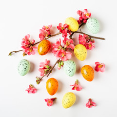 Easter background with eggs and japanese quince