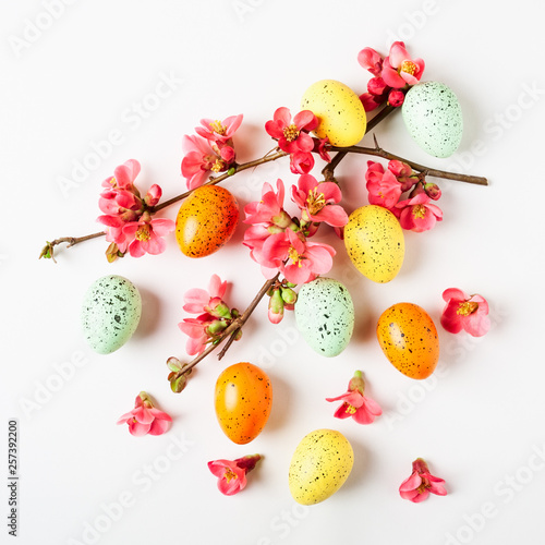 Leinwandbild Motiv Easter background with eggs and japanese quince