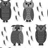seamless pattern of black and white owls and feathers