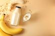 Leinwandbild Motiv Composition with bottle of banana smoothie on color background