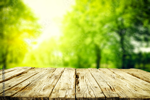 Desk of free space for your decoration and spring blurred background  - 257417453