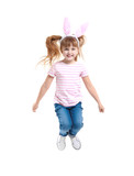 Funny jumping girl with bunny ears on white background
