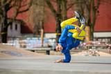 Break dance movement, performer on the street Playground