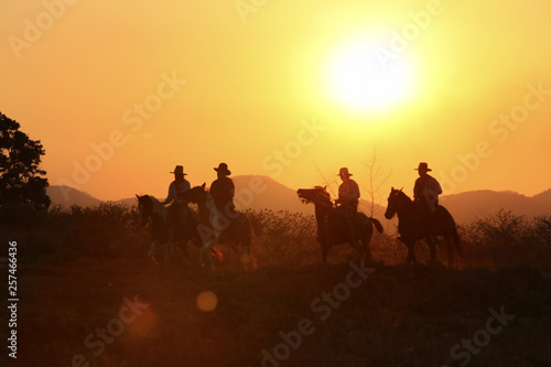 fototapeta na ścianę cowboy and horse at first light,mountain, river and lifestyle with natural sunset light background