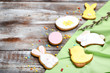 Leinwandbild Motiv Easter gingerbread cookies with willow branch and sprinkles on wooden table