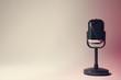 Leinwandbild Motiv Retro microphone on color background. Space for text