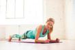 Leinwandbild Motiv Middle aged woman doing plank exercises in studio