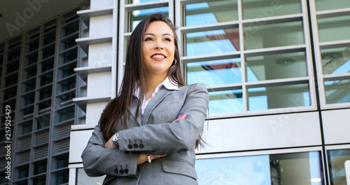canvas print picture Confident young female manager outdoor in a modern urban setting