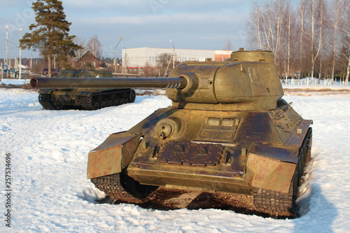 Old battle Tank on the snow, participated in the 2nd world war. © jahet7