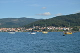 Fototapeta Fototapety na ścianę - Boats Moored Along With Mussel Breeders In The Estuary Of The Muros Village. Nature, Architecture, History, Street Photography. August 19, 2014. Muros, Pontevedra, Galicia, Spain. © Raul H